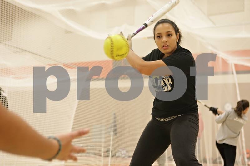 Rob Winner – rwinner@shawmedia.com<br /> <br /> Jessica Townsend works on her swing at softball practice inside the field house at DeKalb High School on Friday, March 15, 2013.