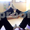 "David Thomas – dthomas@shawmedia.com<br /> <br /> Abby Knapek performs a ""double boat"" with yoga instructor Sue Erickson (right). Erickson recently opened Katerpillar Kids Yoga in Sycamore, and is hosting three sessions at the Midwest Museum of Natural History in Sycamore later this month."