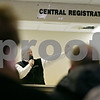 Rob Winner – rwinner@shawmedia.com<br /> <br /> Steve Almburg (center) of Almburg Auctioneering looks for bids during the auctioning of the two previous DeKalb Clinic buildings in DeKalb, Ill., on Thursday, March 21, 2013.