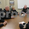 Rob Winner – rwinner@shawmedia.com<br /> <br /> Sgt. Mark Tehan (second from right) addresses fellow police officers during a roll call meeting at the DeKalb Police Department in DeKalb, Ill., Wednesday, March 20, 2013.