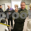 Rob Winner – rwinner@shawmedia.com<br /> <br /> Sgt. Ryan Pettengell (second from right) talks with Marilyn Johnson, of DeKalb, while holding an AR-15 assault rifle during a DeKalb County Sheriff's Citizens Police Academy at the DeKalb County Highway Department on Thursday, March 14, 2013.