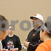 Rob Winner – rwinner@shawmedia.com<br /> <br /> DeKalb softball coach Jeff Davis talks with his team about upcoming canceled games due to the weather at practice inside the field house at DeKalb High School on Friday, March 15, 2013.