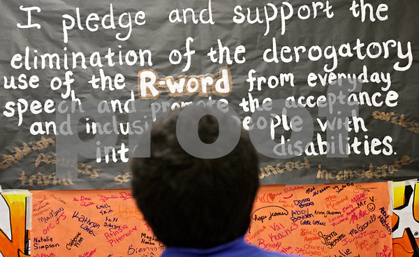 Rob Winner – rwinner@shawmedia.com<br /> <br /> A Clinton Rosette Middle School student looks over a poster which supports the elimination of the derogatory use of the word 'Retard' in DeKalb, Ill., Tuesday, March 19, 2013.