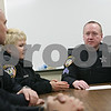 Rob Winner – rwinner@shawmedia.com<br /> <br /> Sgt. Mark Tehan (right) addresses fellow police officers during a roll call meeting at the DeKalb Police Department in DeKalb, Ill., Wednesday, March 20, 2013.