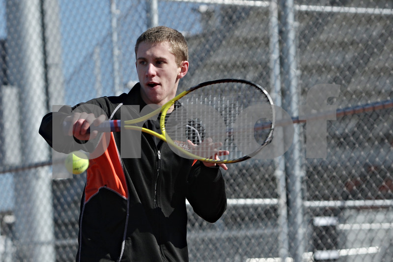 Rob Winner – rwinner@shawmedia.com<br /> <br /> Ben Hart, a senior, participates in the DeKalb's tennis team's first outdoor practice at DeKalb High School on Thursday, March 21, 2013.