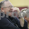 "Rob Winner – rwinner@shawmedia.com<br /> <br /> Dale and Sandra Gentry, of Chana, react while listening to the kindergarten class sing ""America"" during a musical performance for guests to Grandparents Day at Shabbona Elementary School on Friday, March 22, 2013. The Gentrys have two grandchildren that attend the school including Jacob Coulter, a kindergartener, and Emily Coulter, a fourth grader."