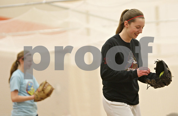 Rob Winner – rwinner@shawmedia.com<br /> <br /> Pitchers Katie Kowalski (right) and Morgan Newport share a laugh during softball practice inside the field house at DeKalb High School on Friday, March 15, 2013.