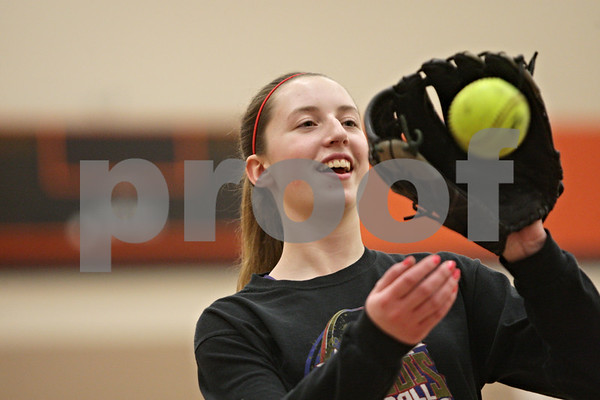 Rob Winner – rwinner@shawmedia.com<br /> <br /> Katie Kowalski plays catch during softball practice inside the field house at DeKalb High School on Friday, March 15, 2013.