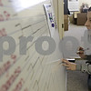 Rob Winner – rwinner@shawmedia.com<br /> <br /> Emily Olson, of School Tool Box in Sycamore, recreates the bracket for this year's NCAA basketball tournament on a large board before an office pool on Monday, March 18, 2013.