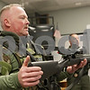 Rob Winner – rwinner@shawmedia.com<br /> <br /> Sgt. Brad Carls holds up a Remington 700 sniper rifle during a DeKalb County Sheriff's Citizens Police Academy at the DeKalb County Highway Department on Thursday, March 14, 2013.
