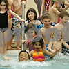 Rob Winner – rwinner@shawmedia.com<br /> <br /> Sycamore students part of the OSCAR program get into one of the pools at the Kishwaukee Family YMCA in Sycamore, Ill., Friday, March 22, 2013. OSCAR stands for out of school care. Sycamore schools started their spring break on Friday and will return for class on Monday, April 1.