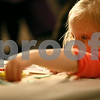 Erik Anderson - For the Daily Chronicle <br /> Lillian Beck, 3, of DeKalb plays with crayons while making a greeting card during the morning festivities of Breakfast with the Bunny at the Egyptian Theater in downtown DeKalb on Saturday, March 23, 2013.