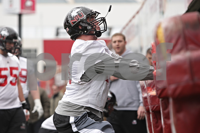 Rob Winner – rwinner@shawmedia.com<br /> <br /> Northern Illinois offensive lineman Ryan Brown participates in a drill during practice at Huskie Stadium in DeKalb, Ill., Wednesday, March 27, 2013.