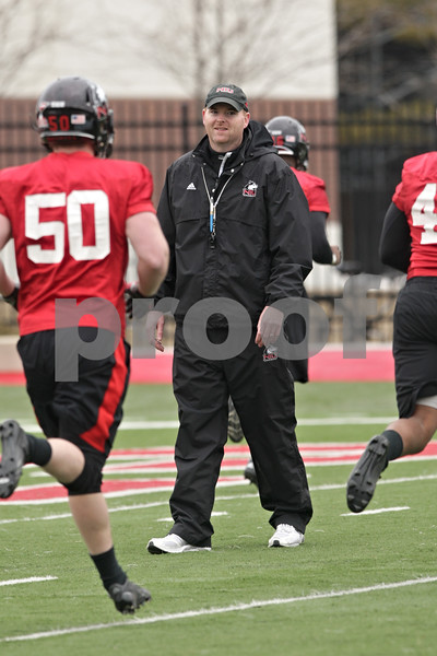 Rob Winner – rwinner@shawmedia.com<br /> <br /> Northern Illinois football coach Rod Carey (center) during practice at Huskie Stadium in DeKalb, Ill., Wednesday, March 27, 2013.