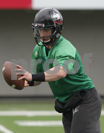 Rob Winner – rwinner@shawmedia.com<br /> <br /> Northern Illinois quarterback Jordan Lynch fakes a handoff during practice at Huskie Stadium in DeKalb, Ill., Wednesday, March 27, 2013.