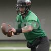 Rob Winner – rwinner@shawmedia.com<br /> <br /> Northern Illinois quarterback Jordan Lynch fakes a handoff during practice at Huskie Stadium in DeKalb, Ill., Wednesday, March 27, 2013.