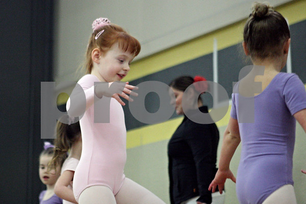 Rob Winner – rwinner@shawmedia.com<br /> <br /> 4-year-old Alise Goodman, of Sycamore, ballet dances with her classmates from the Performing Arts Academy during a performance at the 2013 Community Expo inside the field house at Sycamore High School on Tuesday, March 26, 2013.
