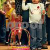 Erik Anderson - For the Daily Chronicle <br /> Mark Peterson of DeKalb helps his daughter Lauren, 2, with an egg toss game during the morning festivities of Breakfast with the Bunny at the Egyptian Theater in downtown DeKalb on Saturday, March 23, 2013.