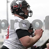 Rob Winner – rwinner@shawmedia.com<br /> <br /> Northern Illinois center Michael Gegner participates in a drill during practice at Huskie Stadium in DeKalb, Ill., Wednesday, March 27, 2013.