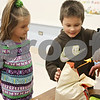 Rob Winner – rwinner@shawmedia.com<br /> <br /> Twins Danielle (left) and Dillon Bulson, both 6, work together while planting marigolds during a school project at Hinckley-Big Rock Elementary School in Hinckley, Ill., Wednesday, March 20, 2013, in Hinckley, Ill. The Bulsons are one of five sets of twins that attend kindergarten at H-BR Elementary School.