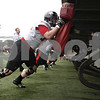 Rob Winner – rwinner@shawmedia.com<br /> <br /> Northern Illinois offensive lineman Josh Ruka (front) participates in a drill during practice at Huskie Stadium in DeKalb, Ill., Wednesday, March 27, 2013.