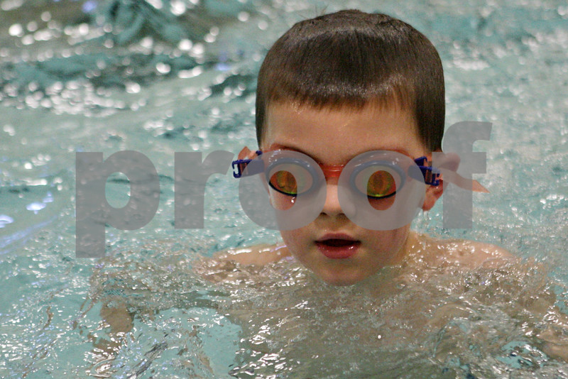 Rob Winner – rwinner@shawmedia.com<br /> <br /> Holden Austin of North Grove Elementary in Sycamore swims in a pool at the Kishwaukee Family YMCA in Sycamore, Ill., Friday, March 22, 2013. Austin is part of the OSCAR program, or out of school care program, which involves a partnership between Sycamore schools and the YMCA. Sycamore schools started their spring break on Friday and will return for class on Monday, April 1.