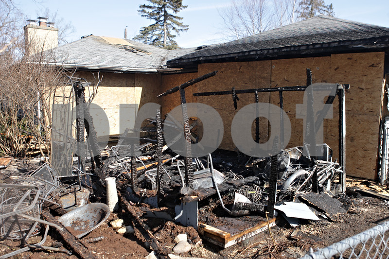 Rob Winner – rwinner@shawmedia.com<br /> <br /> The morning after a fire occurred on the 800 block of Lawnwood Avenue in DeKalb, Ill., shows the damage a home sustained on Thursday, March 28, 2013.
