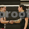 Rob Winner – rwinner@shawmedia.com<br /> <br /> Badminton players Tristan Draper (left), a junior, and Jaci Nguyen, a senior, shake hands after a practice game at DeKalb High School on Thursday, March 21, 2013.
