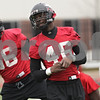 Rob Winner – rwinner@shawmedia.com<br /> <br /> Northern Illinois defensive end George Rainey (46) stretches with his teammates during practice at Huskie Stadium in DeKalb, Ill., Wednesday, March 27, 2013.