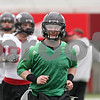 Rob Winner – rwinner@shawmedia.com<br /> <br /> Northern Illinois quarterback Jordan Lynch (center) jogs during the start of practice at Huskie Stadium in DeKalb, Ill., Wednesday, March 27, 2013.