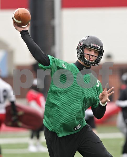Rob Winner – rwinner@shawmedia.com<br /> <br /> Northern Illinois quarterback Matt Williams makes a pass during practice at Huskie Stadium in DeKalb, Ill., Wednesday, March 27, 2013.