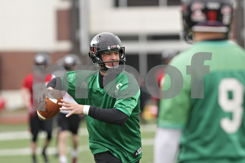 Rob Winner – rwinner@shawmedia.com<br /> <br /> Northern Illinois quarterback Matt Williams looks to pass during practice at Huskie Stadium in DeKalb, Ill., Wednesday, March 27, 2013.