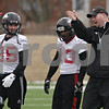 Rob Winner – rwinner@shawmedia.com<br /> <br /> Northern Illinois football coach Rod Carey (right) instructs his players including Angelo Sebastiano (85) and Charlie Miller (13) during practice at Huskie Stadium in DeKalb, Ill., Wednesday, March 27, 2013.