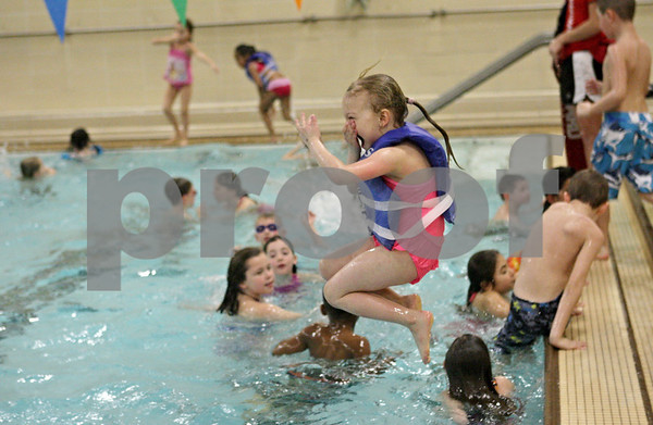 Rob Winner – rwinner@shawmedia.com<br /> <br /> MacKenzie Ferguson of Southeast Elementary in Sycamore jumps into a pool at the Kishwaukee Family YMCA in Sycamore, Ill., Friday, March 22, 2013. Ferguson is part of the OSCAR program, or out of school care program, which involves a partnership between Sycamore schools and the YMCA. Sycamore schools started their spring break on Friday and will return for class on Monday, April 1.<br /> <br /> ***Feel free to put text on the image. -Rob***