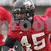 Rob Winner – rwinner@shawmedia.com<br /> <br /> Northern Illinois linebacker Boomer Mays (45) runs a drill during practice at Huskie Stadium in DeKalb, Ill., Wednesday, March 27, 2013.