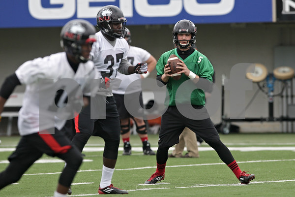 Rob Winner – rwinner@shawmedia.com<br /> <br /> Northern Illinois quarterback Matt Williams looks for a receiver during practice at Huskie Stadium in DeKalb, Ill., Wednesday, March 27, 2013.