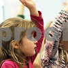 Rob Winner – rwinner@shawmedia.com<br /> <br /> Twins Elisabeth (left) and Makena Snelling, 6, raise their hands during a presentation on maple syrup at Hinckley-Big Rock Elementary School in Hinckley, Ill., Wednesday, March 20, 2013. The Snelling sisters are one of five sets of twins that attend kindergarten at H-BR Elementary School.