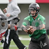 Rob Winner – rwinner@shawmedia.com<br /> <br /> Northern Illinois quarterback Jordan Lynch (center) fakes a handoff to Giorgio Bowers (left) during practice at Huskie Stadium in DeKalb, Ill., Wednesday, March 27, 2013.