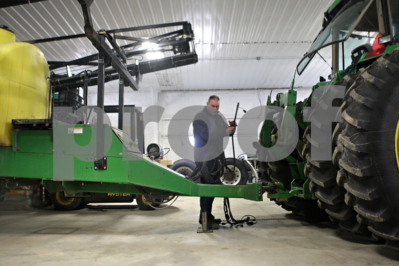Rob Winner – rwinner@shawmedia.com<br /> <br /> Mike Schweitzer begins attaching a field sprayer to a tractor while preparing for the upcoming planting season in Malta, Ill., Wednesday, March 27, 2013.