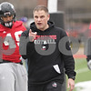 Rob Winner – rwinner@shawmedia.com<br /> <br /> Northern Illinois defensive line coach Brett Diersen works with his players during practice at Huskie Stadium in DeKalb, Ill., Wednesday, March 27, 2013.