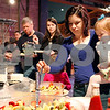 "Erik Anderson - For the Daily Chronicle <br /> DeKalb mother, Emily Miner, scoops out pieces of fruit for her daughter Charlotte, 2, during Breakfast with the Bunny at the Egyptian Theater in downtown DeKalb on Saturday, March 23, 2013. The event started with breakfast at 9 a.m. then the festivities until 10:30 a.m. and finally the showing of the movie, ""Hop"" at 11 a.m."