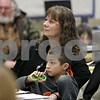 Rob Winner – rwinner@shawmedia.com<br /> <br /> Vonda Lopez sits with her grandson Jackson Lopez in Denise Myers (not pictured) third grade classroom during Grandparents Day at Shabbona Elementary School on Friday, March 22, 2013.