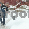 Kyle Bursaw – kbursaw@shawmedia.com<br /> <br /> Joe Lendino shovels the sidewalk in front of Hearing Help Express in DeKalb, Ill. on Tuesday, March 5, 2013.