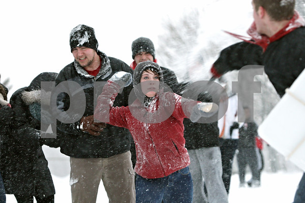 Rob Winner – rwinner@shawmedia.com<br /> <br /> Northern Illinois student Jaclyn Fowler (center) looks to retaliate  while participating in a snowball fight outside University Plaza in DeKalb, Ill., Tuesday, March 5, 2013.