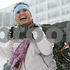 Rob Winner – rwinner@shawmedia.com<br /> <br /> Northern Illinois student Maddie Greene laughs before being tackled to the ground while participating in a snowball fight outside University Plaza in DeKalb, Ill., Tuesday, March 5, 2013.