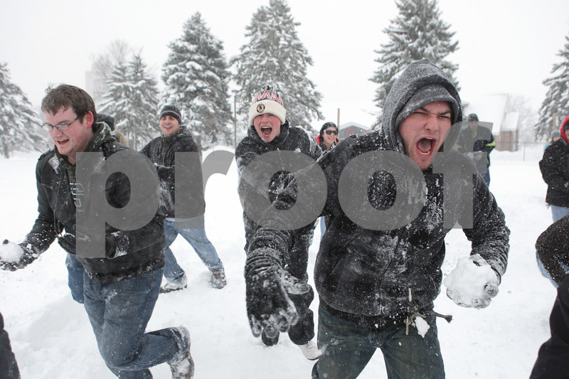 Rob Winner – rwinner@shawmedia.com<br /> <br /> Northern Illinois students participate in a snowball fight outside University Plaza in DeKalb, Ill., Tuesday, March 5, 2013.