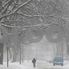 Kyle Bursaw – kbursaw@shawmedia.com<br /> <br /> A man walks down a snowy Fisk Avenue in DeKalb, Ill. on Tuesday, March 5, 2013.