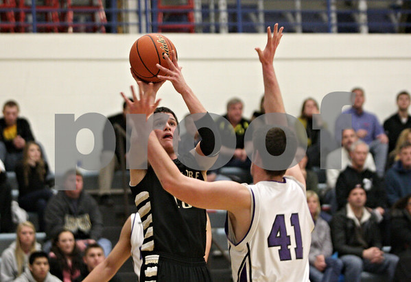 Rob Winner – rwinner@shawmedia.com<br /> <br /> Sycamore's Devin Mottet puts up a shot over Hampshire's Shane Hernandez (41) in the first quarter during the Class 3A Burlington Central Regional final in Burlington, Ill., Friday, Mar. 1, 2013.