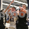 Rob Winner – rwinner@shawmedia.com<br /> <br /> Sycamore's Mark Skelley (left to right), Hampshire's Shane Hernandez and Sycamore's Scott Nelson try to conrol a rebound under the Whip-Purs' basket in the second quarter during the Class 3A Burlington Central Regional final in Burlington, Ill., Friday, Mar. 1, 2013.