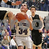 Rob Winner – rwinner@shawmedia.com<br /> <br /> Hampshire's Michael Dumoulin (34) draws a foul from Sycamore's Devin Mottet (15) before making a shot in the second quarter during the Class 3A Burlington Central Regional final in Burlington, Ill., Friday, Mar. 1, 2013.